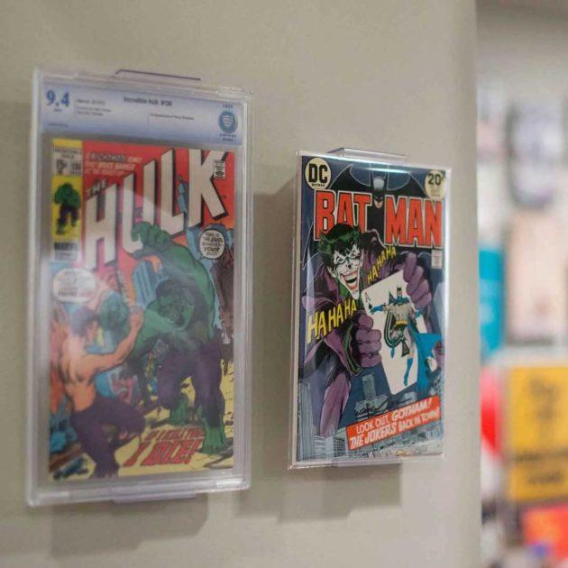 Wall mounts for showcasing comic books